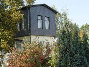 Henke Dachdecker für Rinteln - Fassadenverkleidung mit Naturschiefer